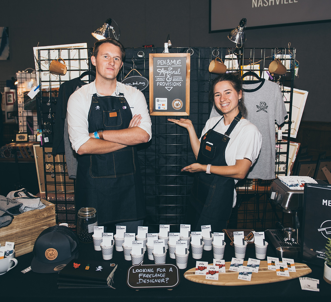 Austin and Lexi Schulenburg of Pen & Mug at their booth at a Nashville pop-up marketplace.